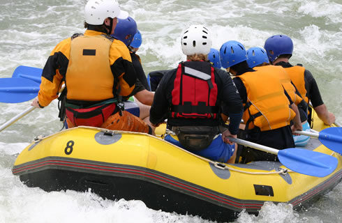 Picture of people whitewater rafting.