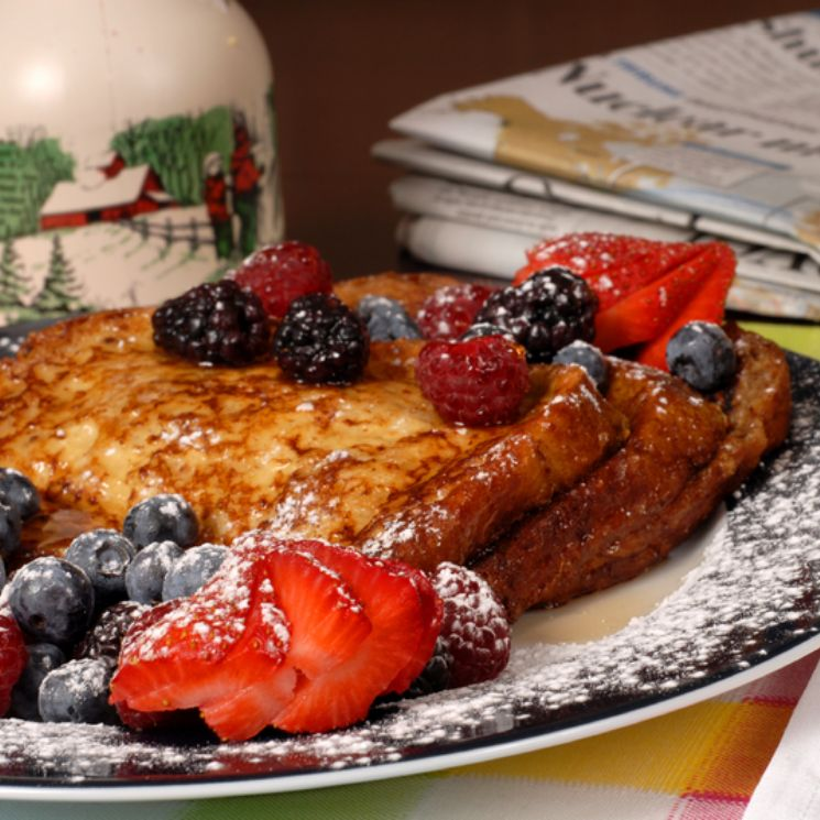 French toast on a page with berries